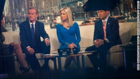 NEW YORK, NY - FEBRUARY 17: Seen through a window, (L to R) hosts Steve Doocy, Ainsley Earhardt, and Brian Kilmeade broadcast 'Fox And Friends' from the Fox News studios, February 17, 2017 in New York City. President Trump, a frequent consumer and critic of cable news, recently tweeted that Fox and Friends is 'great'. (Photo by Drew Angerer/Getty Images)