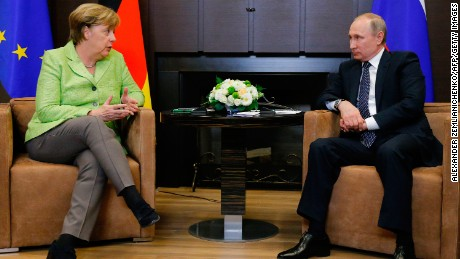 Merkel (L) with Putin at the Bocharov Ruchei residence in Sochi on Tuesday.