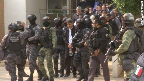 Dámaso López Nuñez is escorted by police after his capture at an apartment building in Mexico City.