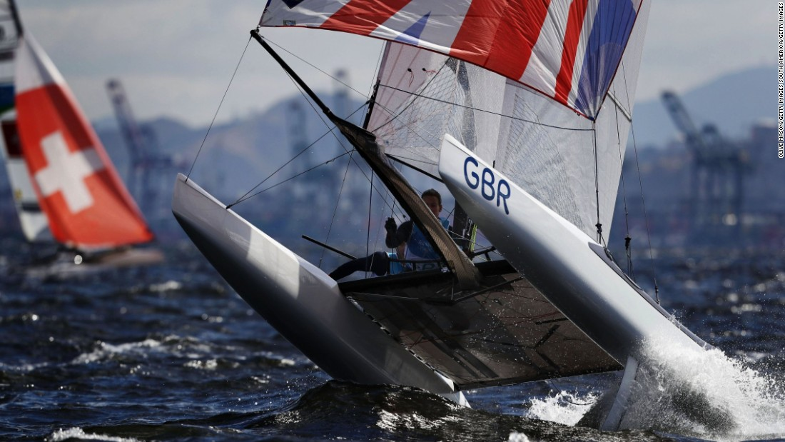 "Mason describes the image of Scott's elation as ""one the nicest, cleanest"" he's ever taken -- telling CNN Sport  the ultimate aim is always ""a picture that tells a story with a key moment, key athlete and beautiful light.""  But sometimes it's about pure action. Here, a member of the Nacra 17 Olympic fleet fights with testing winds on the Rio waters."