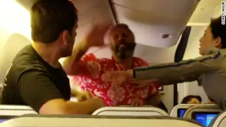 Video captures fistfight between passengers on flight to Los Angeles