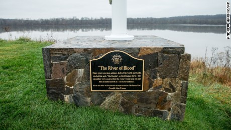 "A plaque that reads ""The River of Blood"" sits at the base of a flagpole between the 14th and 15th hole at the Trump National Golf Club  in Sterling, Va., Wednesday, Dec. 2, 2015. The historical accuracy that ""American soldiers, both of the North and South, died at this spot"" has been called into question by historians. (AP Photo/Andrew Harnik)"