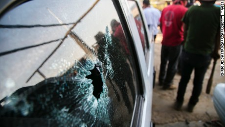 A van with bullet holes is seen following a clash between villagers and state police officers in Arantepacua, Nahuatzen municipality, Michoacan state, Mexico on April 5, 2017. / AFP PHOTO / ENRIQUE CASTRO        (Photo credit should read ENRIQUE CASTRO/AFP/Getty Images)