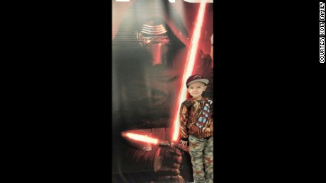 Callan poses in a Chewbacca jacket with a poster of his favorite character, Kylo Ren.