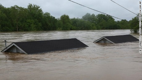 Two rental houses are nearly submerged next to the Meramec River on Opps Lane in Fenton, Missouri.