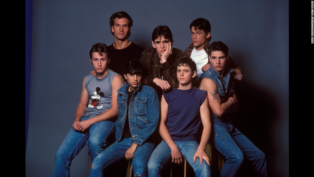 "The cast of ""The Outsiders"" poses for a photo in March 1982. Most of these young actors would later become household names. From left are Emilio Estevez, Patrick Swayze, Ralph Macchio, Matt Dillon, C. Thomas Howell, Rob Lowe and Tom Cruise."