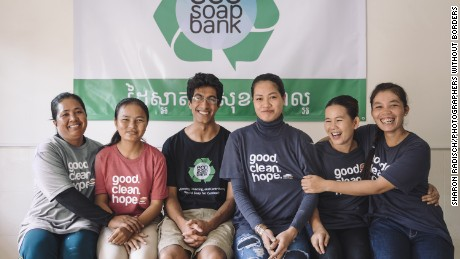 CNN Hero Samir Lakhani, wearing glasses, poses with staff at the Eco-Soap Bank--an organization he founded to provide soap and hygiene education to Cambodians in need.