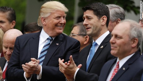 President Donald Trump talks with House Speaker Paul Ryan of Wis., in the Rose Garden of the White House in Washington, Thursday, May 4, 2017, after the House pushed through a health care bill. House Majority Whip Steve Scalise of La. is at left, House Ways and Means Committee Chairman Rep. Kevin Brady, R-Texas is at right. (AP Photo/Evan Vucci)