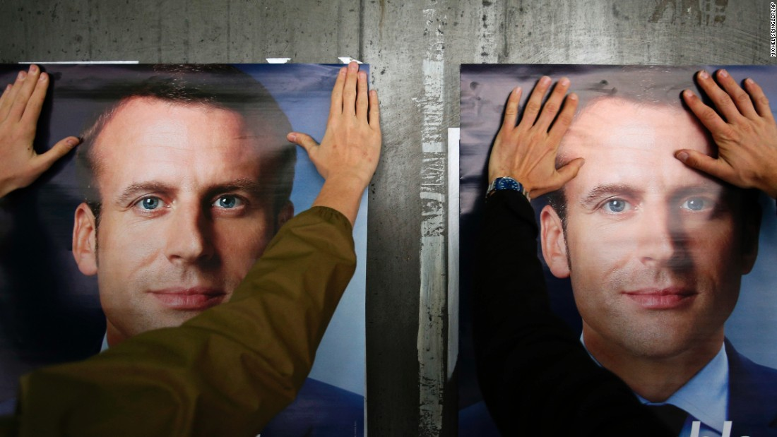 "Supporters of French presidential candidate Emmanuel Macron put up campaign posters in Lille, France, on Tuesday, May 2. Macron faces Marine Le Pen in <a href=""http://www.cnn.com/2017/05/01/europe/french-election-emmanuel-macron/"" target=""_blank"">a runoff</a> this weekend."