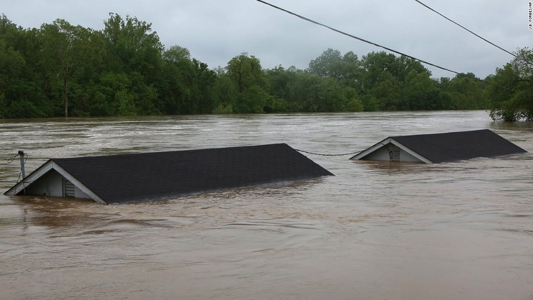 "Two houses are underwater in Fenton, Missouri, on Wednesday, May 3. <a href=""http://www.cnn.com/2017/05/03/us/missouri-severe-weather-flooding/"" target=""_blank"">A new round of rain</a> pounded Missouri, paralyzing a region already suffering from swollen rivers and flooded streets after a heavy downpour last week."