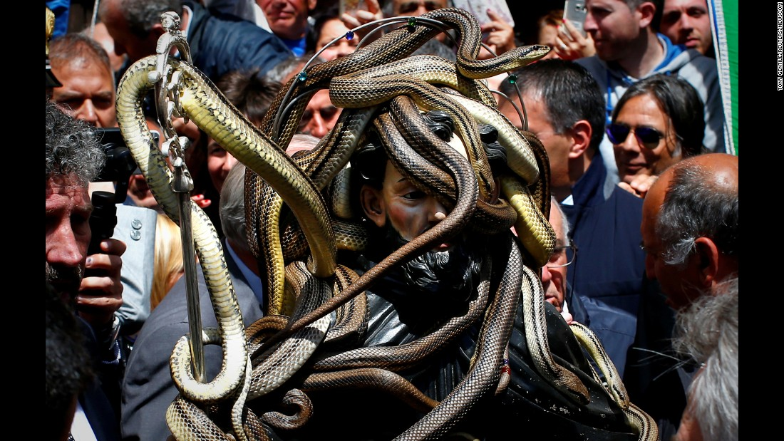 "Snakes cover a wooden statue of St. Dominic during a procession in Cocullo, Italy, on Monday, May 1. Every year, the statue is covered in snakes before being carried around town. St. Dominic of Sora is known as the protector against snakebites, <a href=""https://www.lonelyplanet.com/italy/travel-tips-and-articles/77158"" target=""_blank"">according to the travel guide Lonely Planet.</a>"