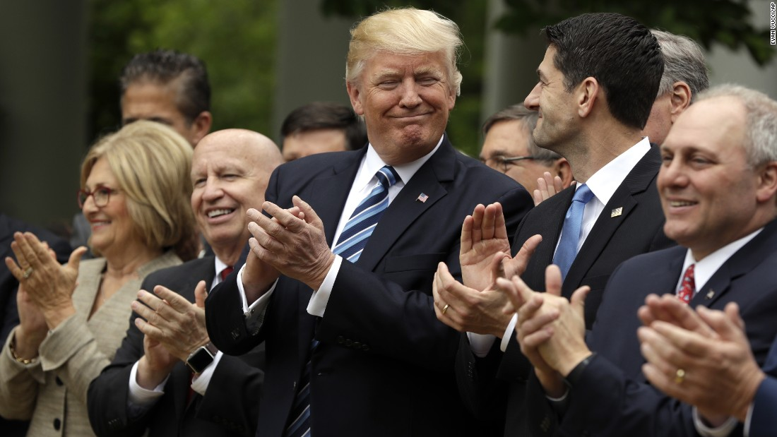 "US President Donald Trump looks at House Speaker Paul Ryan as they applaud <a href=""http://www.cnn.com/2017/05/04/politics/health-care-vote/"" target=""_blank"">the House's passage of a health care bill</a> on Thursday, May 4. ""This is a repeal and replace of Obamacare. Make no mistake about it,"" Trump said during a celebratory White House appearance with House Republicans. The bill now heads to the Senate."