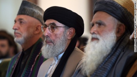 Hekmatyar (center) sits with former Afghan president Hamid Karzai (left) and Afghan former mujahideen leader Abdul Rasul Sayaf (right) during a ceremony at the presidential palace in Kabul.