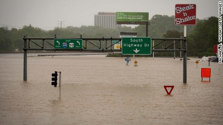 Exit signs on Highway 141 near the Meramec River are submerged on May 4, in Valley Park, Missouri.
