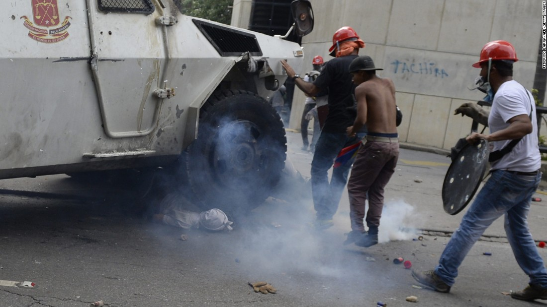 "An armored National Guard vehicle <a href=""http://www.cnn.com/2017/05/05/americas/venezuela-unrest-tank/"" target=""_blank"">runs over a protester</a> in Caracas on Wednesday, May 3. The protester, 22-year-old Pedro Michell Yaminne, survived, his mother told CNN. Interior and justice minister Nestor Reverol told reporters that the ""lamentable"" incident was under investigation. He said that moments before Yaminne was run over, demonstrators hurled a Molotov cocktail at the armored vehicle, opened the side door and ""brutally assaulted"" the driver."