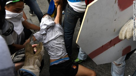 Other protesters helped get Yaminne out of harm's way.