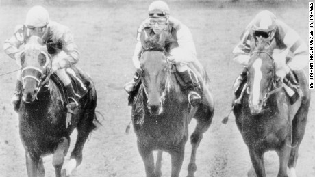 In her 1969 debut, Crump, center, keeps up with Mike Sorentino, left, and Craig Perret at Hialeah Park.