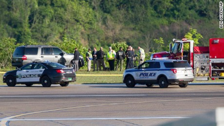 Emergency officials work near the crash site Friday at Yeager Airport.