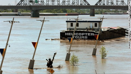 The Captains' Return statue, which honors explorers Lewis and Clark, sits partially submerged on May 5, in a flooding Mississippi River in St. Louis. The statue was just moved to higher ground to avoid floods.