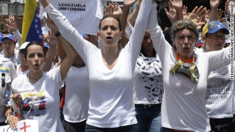 Venezuelan opposition ex-congresswoman Maria Corina Machado (C) takes part in a women's march aimed to keep pressure on President Nicolas Maduro, whose authority is being increasingly challenged by protests and deadly unrest, in Caracas on May 6, 2017. The death toll since April, when the protests intensified after Maduro's administration and the courts stepped up efforts to undermine the opposition, is at least 36 according to prosecutors.  / AFP PHOTO / FEDERICO PARRAFEDERICO PARRA/AFP/Getty Images