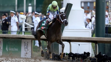 LOUISVILLE, KY - MAY 06:  Jockey John Velazquez celebrates as he guides Always Dreaming #5 across the finish line to win the 143rd running of the Kentucky Derby at Churchill Downs on May 6, 2017 in Louisville, Kentucky.  (Photo by Rob Carr/Getty Images)