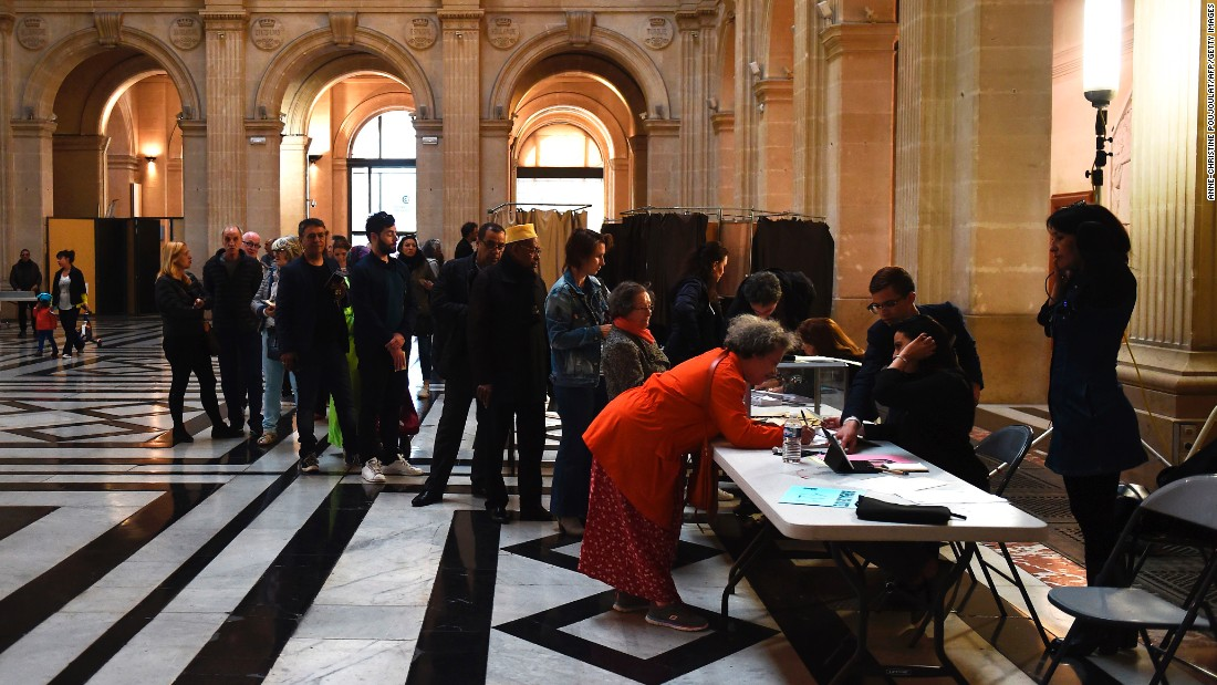 People queue at a polling station in Marseille, France.