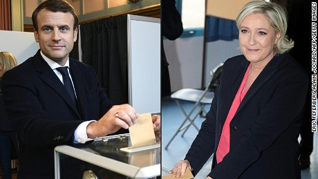 French presidential candidates Emmanuel Macron, left, and Marine Le Pen casting their votes Sunday.