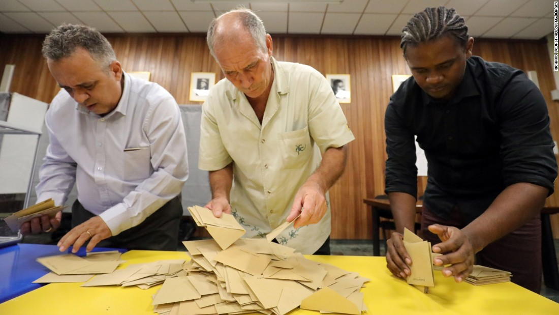 Polling officials count the ballots on May 7, in Saint-Denis de la Reunion, on the French Indian Ocean island of La Reunion. French citizens worldwide are casting their votes during the second round of the country's presidential vote.
