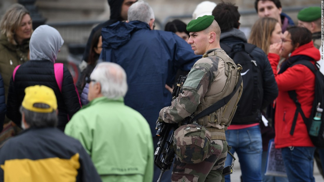 Soldiers patrol the grounds around The Louvre in Paris on May 7 where Emmanuel Macron will celebrate later should he win the election. Earlier in the day the The Louvre was cleared due to a security alert.
