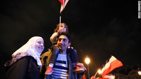 Anas Ammounah, a Syrian refugee, attends the celebrations with his family in Paris on May 7.