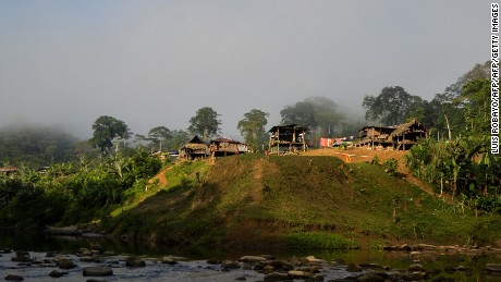 General view of Tasi, a rural village in Alto Baudo, department of Choco, western Colombia, on January 26, 2017.  Despite the peace deal signed by the Colombian government and the FARC rebels, a turf war for control over drug trafficking routes in the isolated department of Choco continues to rage between the smaller ELN guerrilla group and the Autodefensas Gaitanistas de Colombia, a criminal gang that emerged after the paramilitary demobilization a decade ago. / AFP / LUIS ROBAYO / TO GO WITH AFP STORY BY ALINA DIESTE        (Photo credit should read LUIS ROBAYO/AFP/Getty Images)