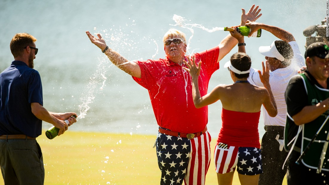 Legendary golfer John Daly is sprayed with champagne after winning a Champions tour event in The Woodlands, Texas, on Sunday, May 7. It was his first tournament win in 13 years.