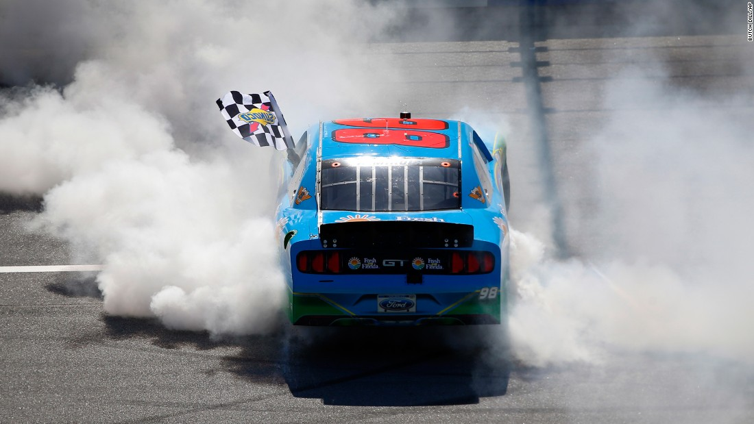 NASCAR driver Aric Almirola celebrates with a burnout after winning the Xfinity Series race in Talladega, Alabama, on Saturday, May 6.