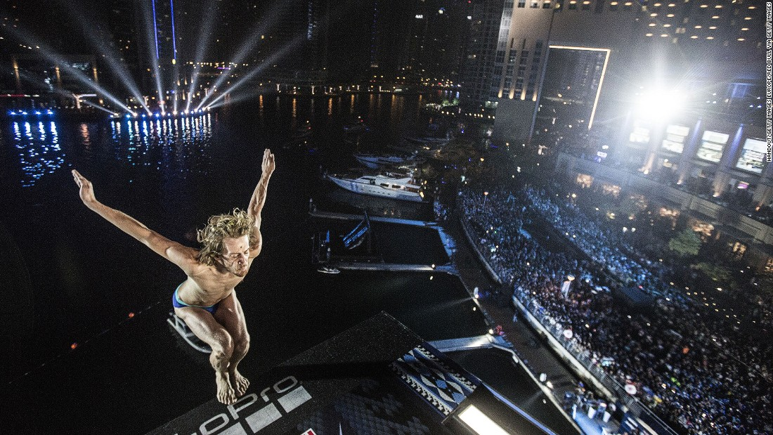 Requiring nerves of steel, the Red Bull Cliff Diving series showcases an elite set of the world's best super-high divers. In October 2016 the series stopped off at the Dubai Marina Pier. Pictured is Gary Hunt of the UK taking a leap off the 89 feet platform.<br />
