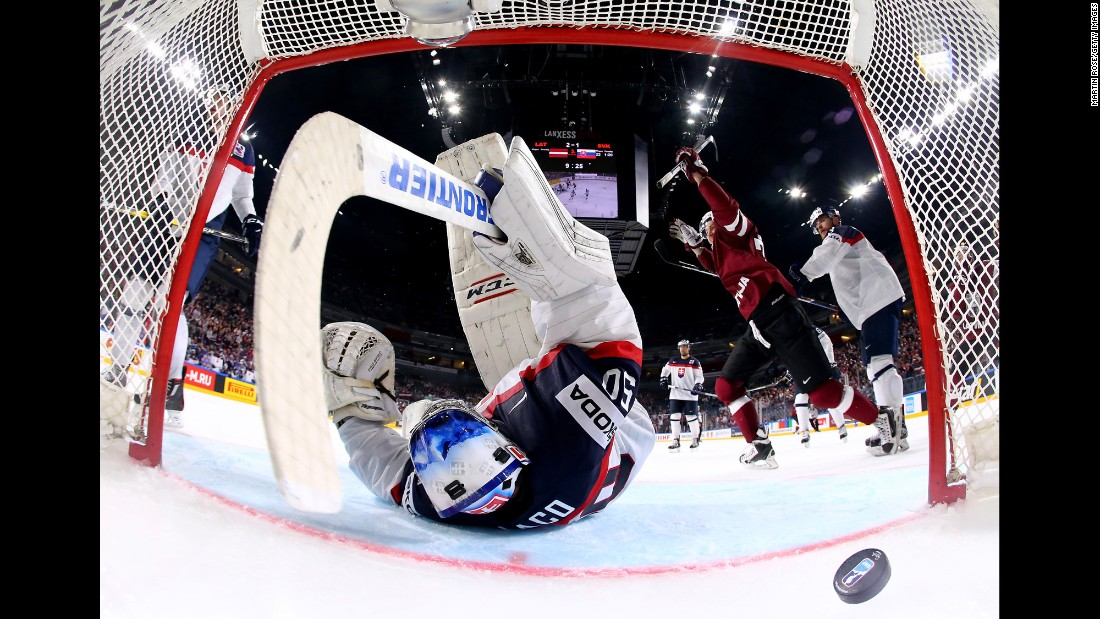 Latvia's Miks Indrasis, right, celebrates a goal against Slovakia during the World Championships on Sunday, May 7. Latvia won the preliminary-round game 3-1.