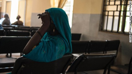 A woman sits in the waiting room of the Federal Neuro Psychiatric Hospital in Maiduguri the capital of Borno State, northeastern Nigeria on September 16, 2016.  The Federal Neuro Psychiatric Hospital has seen a surge in patients with disorders ranging from PTSD (post-traumatic stress disorder), depression, substance abuse, psychosis and anxiety since the beginning of the Boko Haram insurgency in 2009. In July, the United Nations said nearly 250,000 children under five could suffer from severe acute malnutrition this year in Borno state alone and one in five -- some 50,000 -- could die. But despite the huge numbers involved, the situation has received little attention compared with other humanitarian crises around the world -- even within Nigeria. / AFP / STEFAN HEUNIS        (Photo credit should read STEFAN HEUNIS/AFP/Getty Images)
