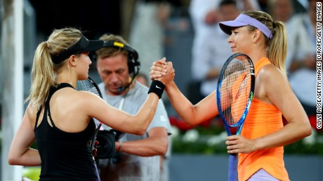 Sharapova shakes hands with Bouchard after losing to the Canadian in the second round of the Madrid Open.