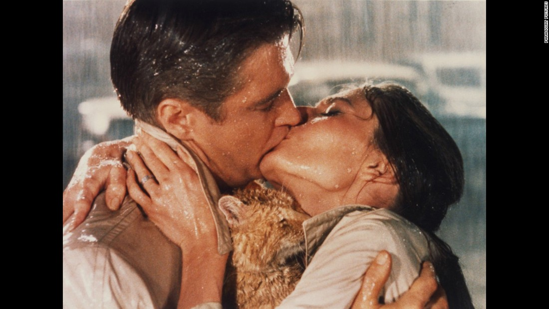 "In an earlier era, the best ""kiss in the rain"" award was often bestowed upon this lip-lock between Holly Golightly (Audrey Hepburn) and Paul (George Peppard) in the 1961 film ""Breakfast at Tiffany's."""