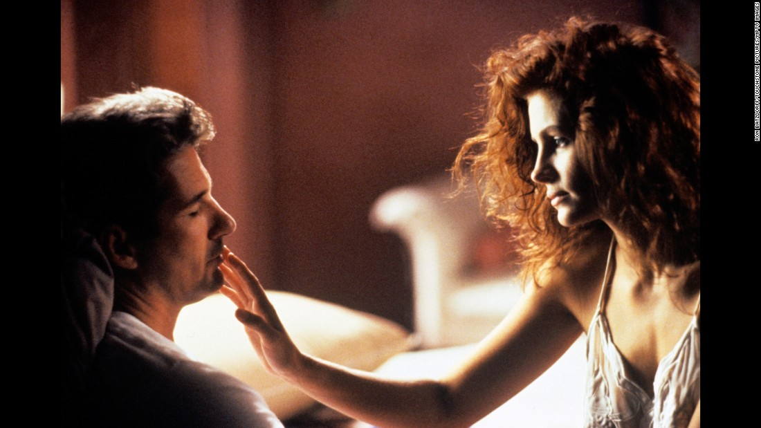 "In ""Pretty Woman,"" Julia Roberts' character, Vivian, is about to break her self-imposed rule as a lady of the night: never kiss a ""trick."" To the vast delight of Edward (Richard Gere), she follows though on this tender touch with a passionate kiss, and he falls hard for her in this 1990 release."
