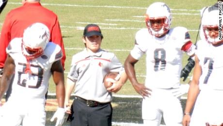 Ryan became the football team's equipment manager. Here, he stands next to 2016 Heisman winner Lamar Jackson (No. 8).
