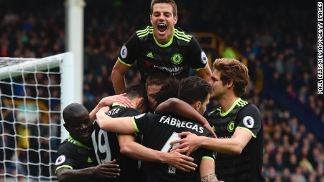 Chelsea's Spanish defender Cesar Azpilicueta (top C) jumps onto the celebration after Chelsea's Brazilian midfielder Willian scored their third goal during the English Premier League football match between Everton and Chelsea at Goodison Park in Liverpool, north west England on April 30, 2017. / AFP PHOTO / PAUL ELLIS / RESTRICTED TO EDITORIAL USE. No use with unauthorized audio, video, data, fixture lists, club/league logos or 'live' services. Online in-match use limited to 75 images, no video emulation. No use in betting, games or single club/league/player publications.  /         (Photo credit should read PAUL ELLIS/AFP/Getty Images)