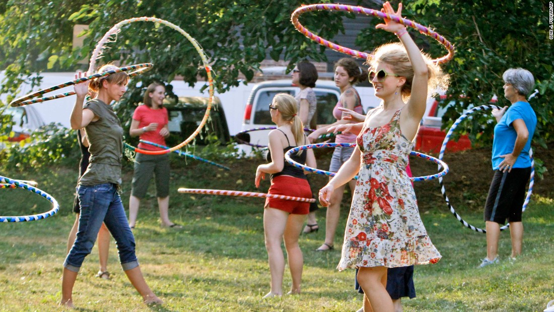 Stephanie Moser, second from right, hoops during an evening hooping class in Pittsburgh. Hula hooping has become hip again, with clubs across the US bringing together hoop aficionados and DVDs incorporating hoops as a way to fight obesity.