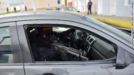 "A student of the Ignacio Zaragoza National Academy of Police Training and Development takes part in a drill on May 14, 2015 in Amozoc, Puebla State, Mexico. The academy was built with resources of the Merida Initiative, an agreement of the US and Mexico ""to fight organized crime and associated violence while furthering respect for human rights and the rule of law"".  AFP PHOTO/RONALDO SCHEMIDT        (Photo credit should read RONALDO SCHEMIDT/AFP/Getty Images)"