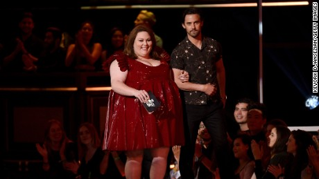 Actors Chrissy Metz and Milo Ventimiglia walk onstage during the 2017 MTV Movie And TV Awards at The Shrine Auditorium on May 7, 2017 in Los Angeles, California.
