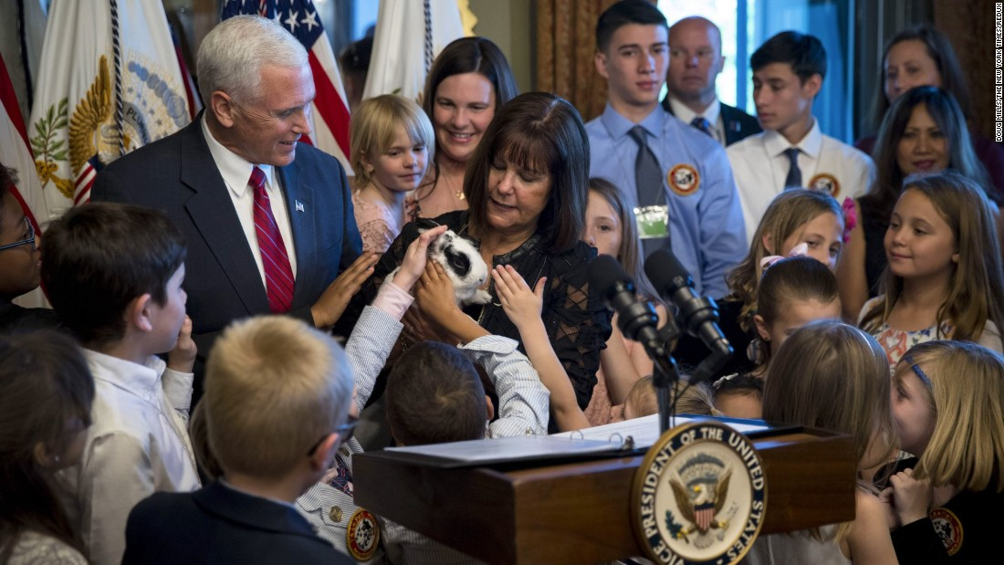 Children gather around Marlon Bundo, the pet bunny of Vice President Mike Pence and his wife, Karen, during a reception for military families Tuesday, May 9, in Washington.