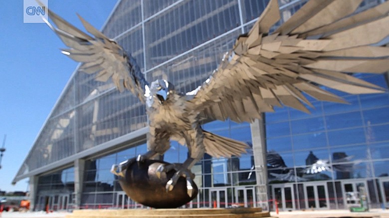 Giant steel falcon takes flight in front of atlanta for Mercedes benz stadium falcon statue