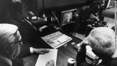 30th April 1973:  White House reporters watch President Richard Nixon on TV as he told the nation of White House involvement in the Watergate scandal, Washington D.C.  (Photo by Hulton Archive/Getty Images)