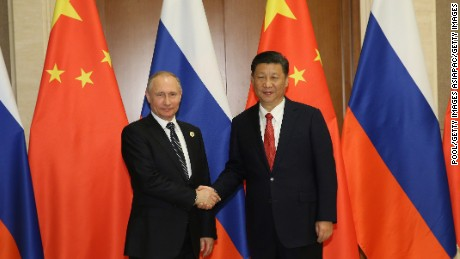 Russian President Vladimir Putin shakes hands with Chinese President Xi Jinping (Photo by Getty Images)