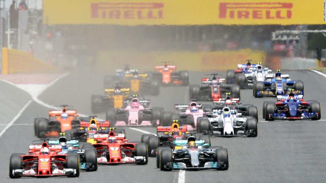 Ferrari's Sebastian Vettel (far left) took the lead at the start but it was Hamilton who eventually prevailed in the 66-lap race.