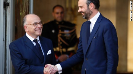 Philippe, right, shakes hands with outgoing Prime Minister Bernard Cazeneuve in Paris, Monday.